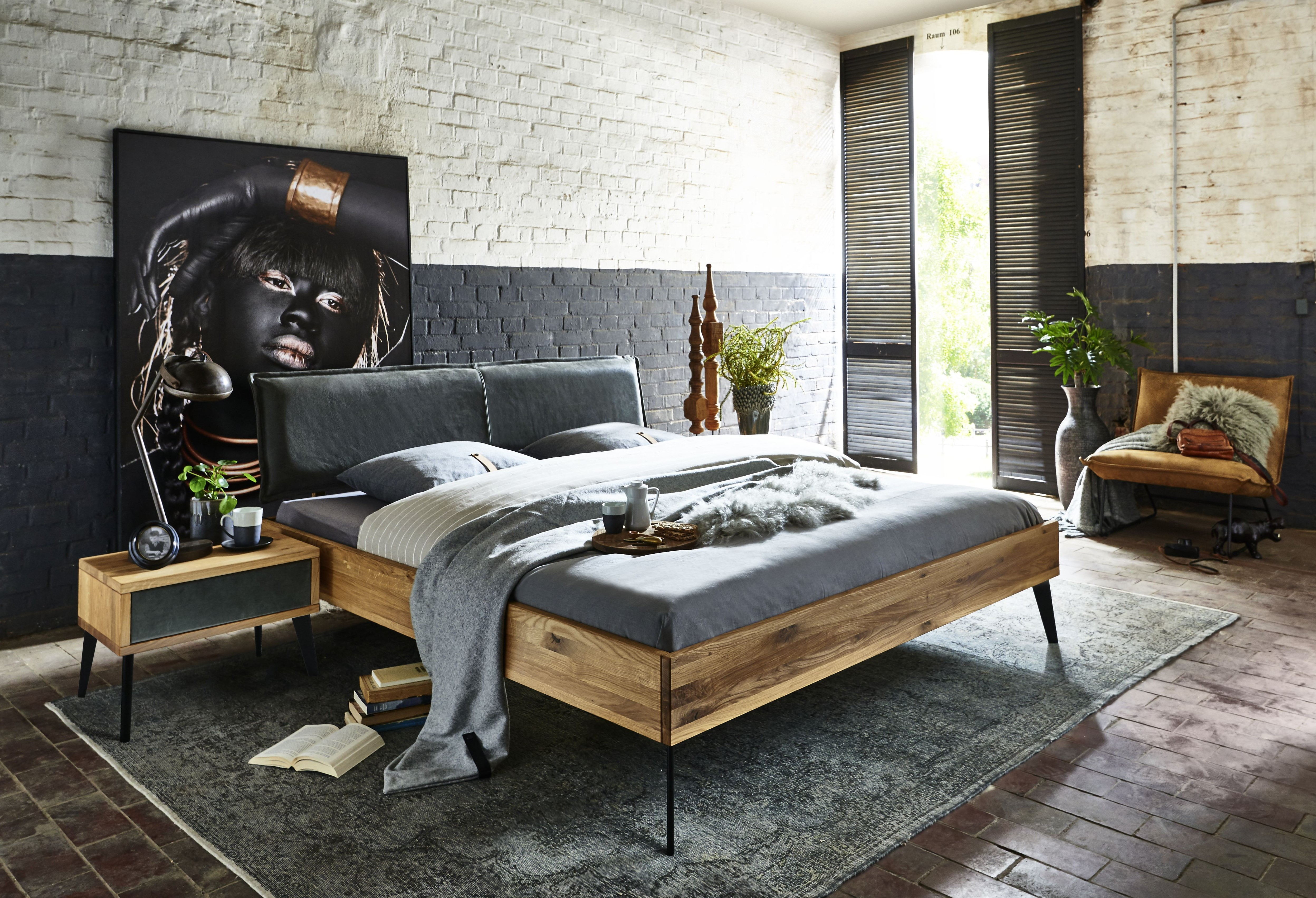 Double bed in solid oak with leather from Tjoernbo